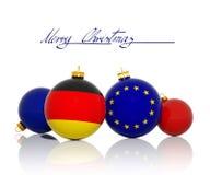 Σφαίρες Χριστουγέννων με τη γερμανική σημαία και τη σημαία της Ευρωπαϊκής Ένωσης Στοκ Φωτογραφία