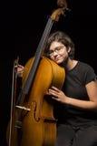 年轻大提琴手休息 库存图片