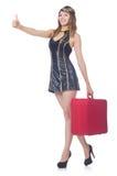 妇女带着手提箱的旅行乘务员 免版税库存图片