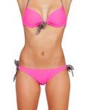 与桃红色游泳衣的有吸引力的女性身体 库存图片