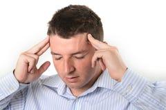 在工作的头疼的商人 免版税库存照片