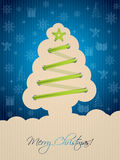 与树鞋带的蓝色圣诞卡 免版税图库摄影