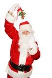 槲寄生下圣诞老人 库存照片