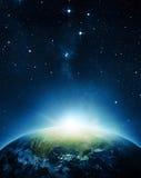 与日出的地球 免版税图库摄影