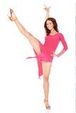 在一件性感的礼服的运动妇女跳舞 库存照片