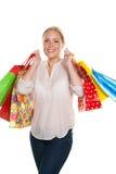 Η γυναίκα με τις αγορές τοποθετεί σε σάκκο ψωνίζοντας Στοκ φωτογραφίες με δικαίωμα ελεύθερης χρήσης