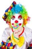 有棒棒糖的小丑 图库摄影