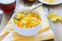 小米粥用南瓜和蜂蜜 库存图片