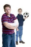 兄弟伤害体育运动 库存图片