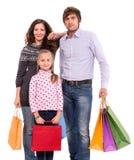 与购物袋的家庭 免版税库存照片