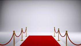 Το κόκκινο χαλί. Γκρίζο υπόβαθρο Στοκ Φωτογραφίες