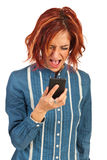 紧张的妇女尖叫对电话 库存图片