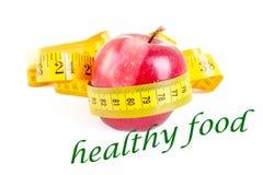 Να κάνει δίαιτα μήλο έννοιας με τη μέτρηση της ταινίας στο λευκό Στοκ φωτογραφία με δικαίωμα ελεύθερης χρήσης