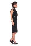 一名年轻时尚妇女的侧视图黑礼服的 库存图片