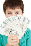 拿着从捷克冠钞票的男孩一个爱好者 库存照片
