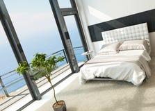 与巨大的窗口的当代现代晴朗的卧室内部 免版税库存图片