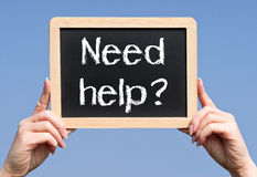 Знак помощи потребности Стоковое Изображение