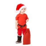 有圣诞老人帽子的小男孩 免版税库存照片