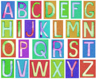 由纸和水彩做的字母表信件 库存图片
