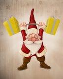 Санта Клаус и самокат нажима Стоковые Фотографии RF