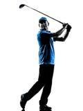 人高尔夫球运动员打高尔夫球的剪影 免版税库存照片
