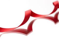 美丽的在白色的织品红色丝带 免版税库存图片