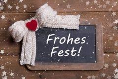 圣诞节的贺卡与红色心脏和德国文本 免版税库存照片