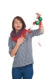 有圣诞节球的少妇 库存图片
