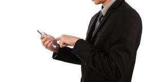 拿着玻璃透明流动,巧妙的电话的商人 免版税库存图片