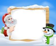 圣诞老人雪人雪场面 免版税库存图片