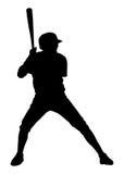 有棒的棒球运动员 图库摄影