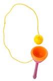 在杯子木玩具的球 免版税库存图片