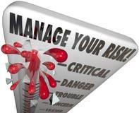 处理您的风险温度计管理极限危险 免版税库存图片