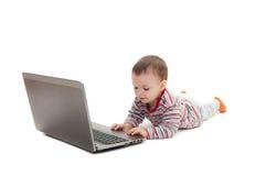 Кнопка ребенка на компьтер-книжке Стоковое Изображение