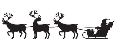 乘坐与驯鹿的圣诞老人一个雪橇 库存图片