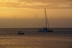 Заход солнца и море Стоковые Изображения