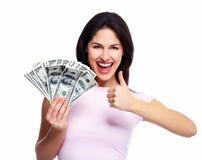 有金钱的愉快的少妇。 免版税图库摄影