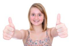 Большие пальцы руки поднимают предназначенную для подростков девушку Стоковые Изображения