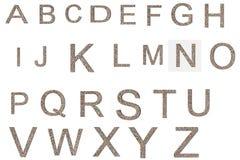 从老和被风化的石墙纹理字母表的字体 免版税库存照片
