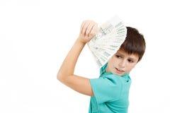 拿着从捷克冠钞票的男孩一个爱好者 免版税库存图片
