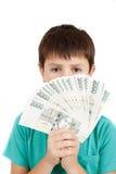 拿着从捷克冠钞票的男孩一个爱好者 免版税库存照片