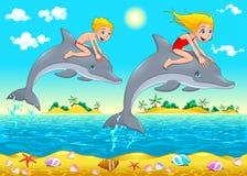 男孩、女孩和海豚在海。 图库摄影