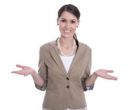 打手势用她的手的微笑的被隔绝的女商人。 免版税库存照片