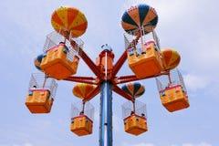 在题材游乐园的五颜六色的特别转盘 库存图片