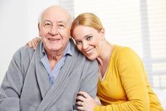与妇女和老人的家庭 库存照片