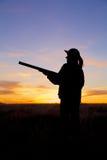 在日落的猎人 库存照片