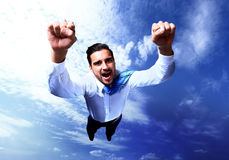 Счастливое летание бизнесмена Стоковые Изображения RF