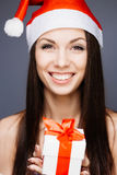 华美的圣诞老人女孩 免版税库存图片