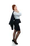 有外套的确信的年轻女商人在她的肩膀 免版税库存图片