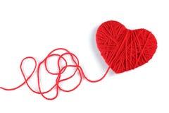 羊毛毛线在心脏形状标志的 免版税库存图片